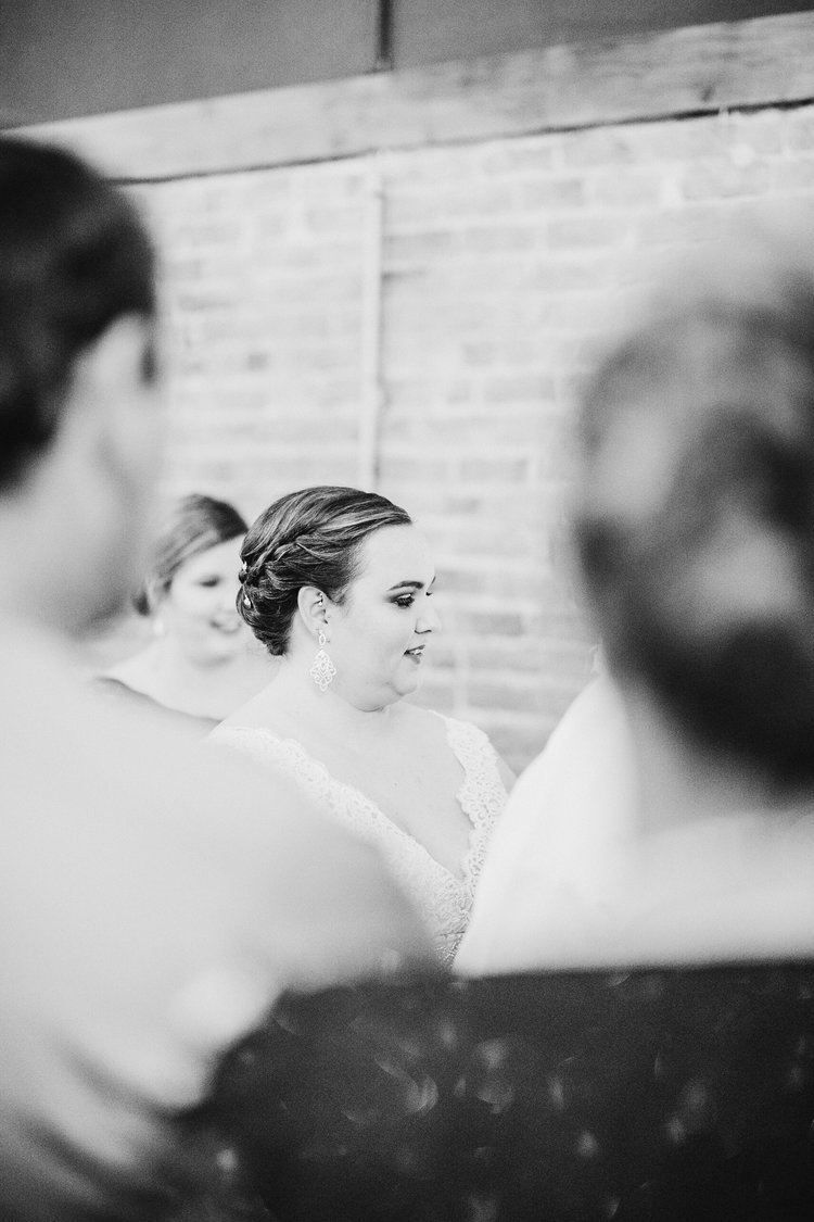 Wedding-Photography_Gatherings-by-Farmhouse-Catering_Nevada-Iowa_vows+bride+looking+away-iowa+wedding+photographer.jpg