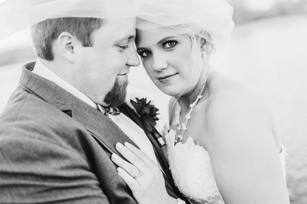 Wedding-Photography-American-Legion-Fairbank-Iowa-bw-upclose-with-viel-and-bride-looking-iowa-wedding-photographer.jpg