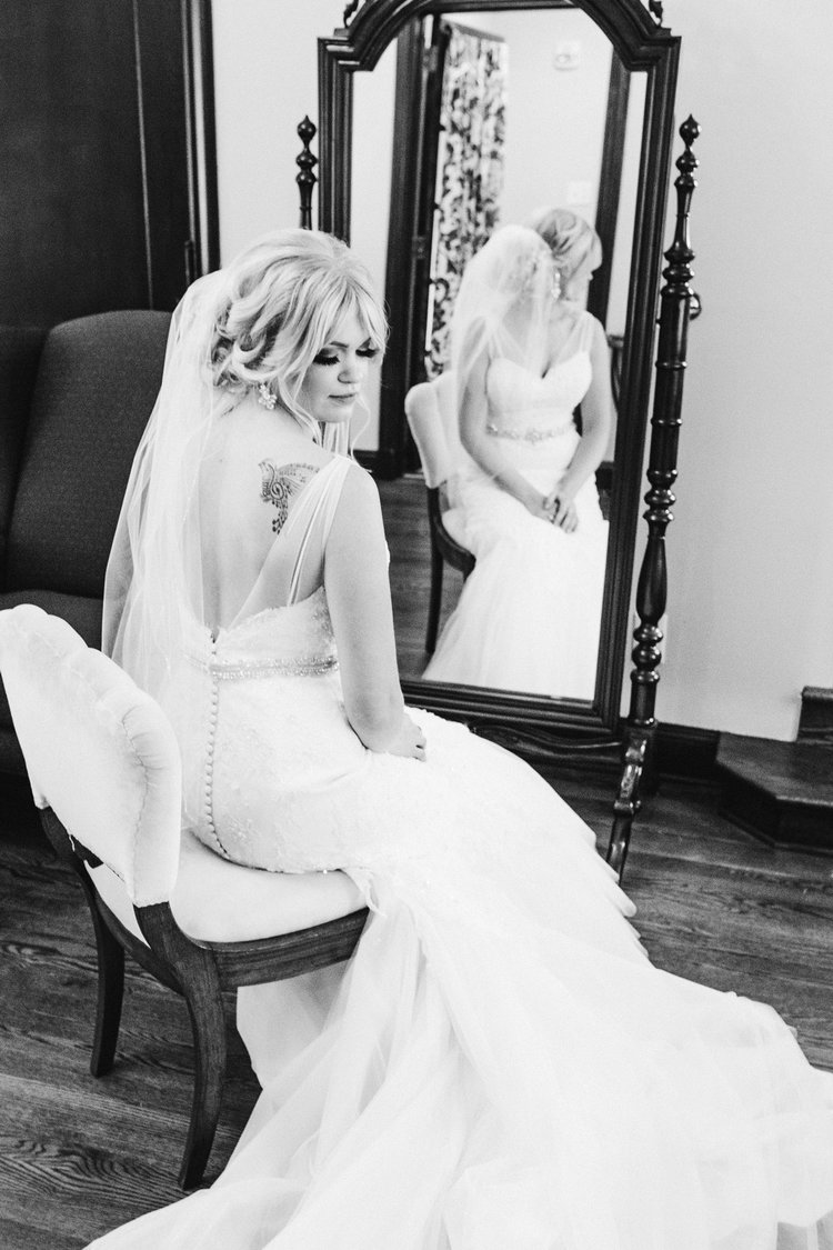 wedding-photography-Rollins-Mansion-Des-Moines-iowa-getting-ready-bride-sitting-on-chair-editorial-iowa-wedding-photographer.jpg