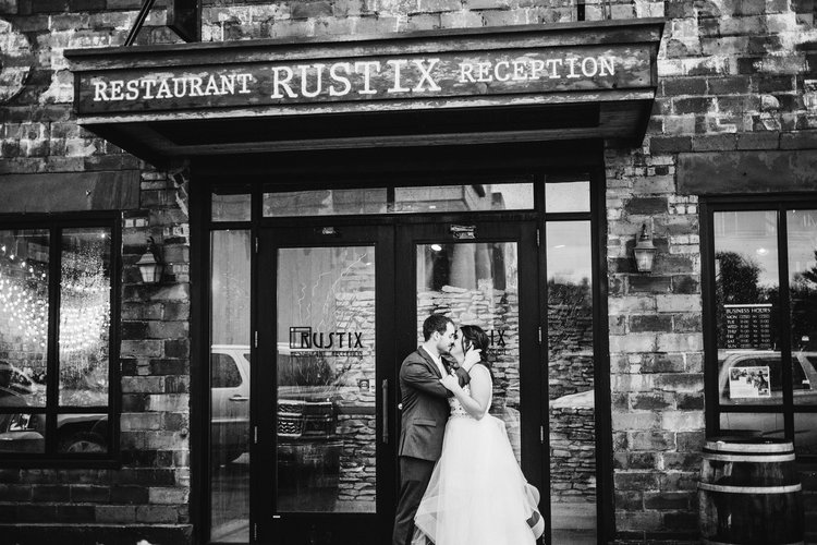 Wedding-Photography-Rustix-Restauarant-and-Reception-Humboldt-Iowa-bride-and-groom-in-front-of-building-iowa-wedding-photographer.jpg