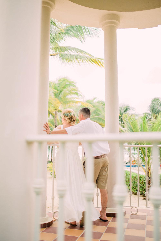 Destination-Wedding-Photography-Riu-Palace-Riviera-Maya-Playa-Del-Carmen-Mexico-bride-and-groom-in-gazebo-looking-at-ocean-and-palm-trees-destination+wedding+photographer.jpg