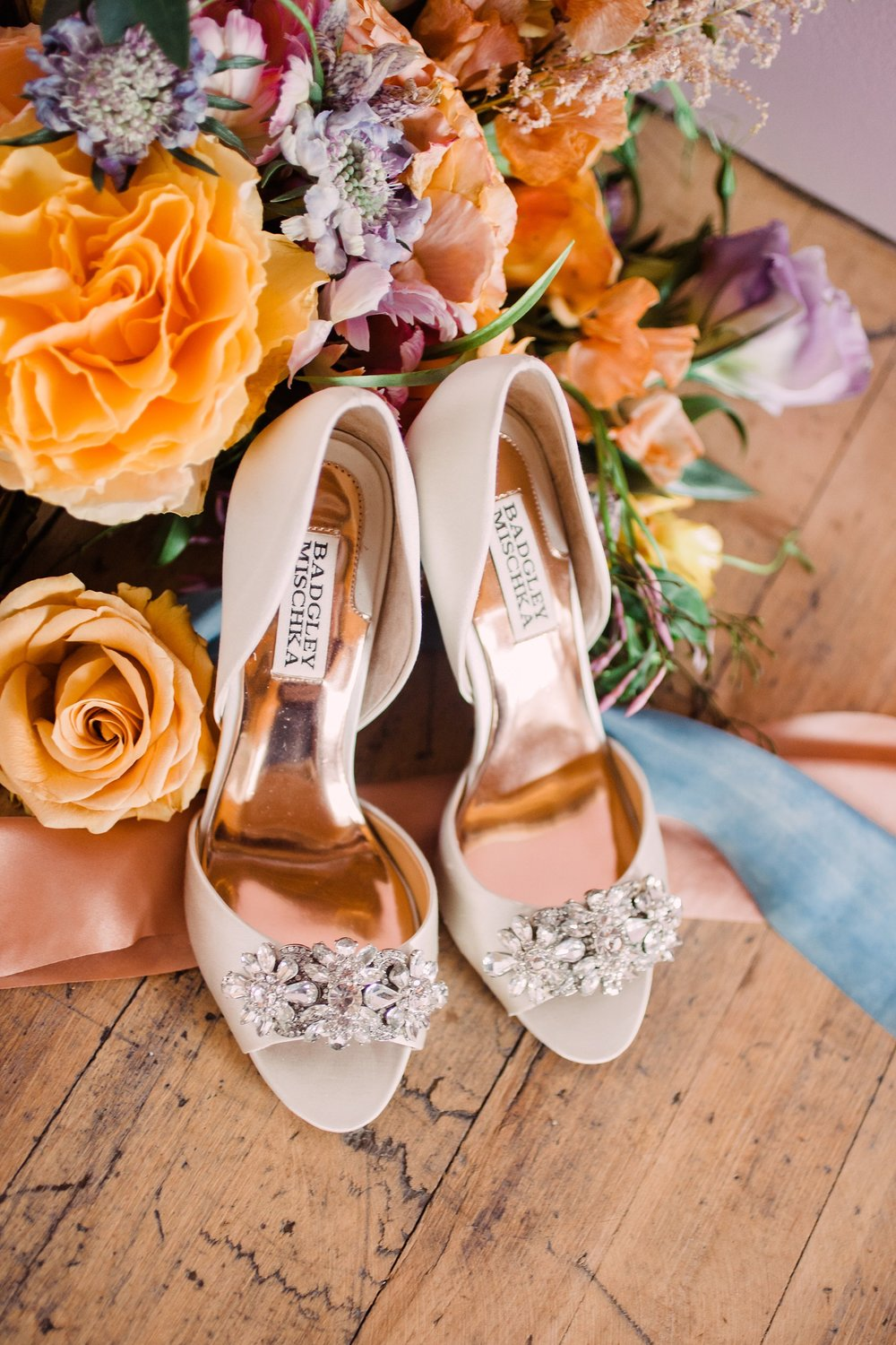Wedding-Photography_August Wolfe Floral Design Styled Shoot-Des Moines-Iowa_bouquet on floor with shoes-iowa+wedding+photographer.jpeg