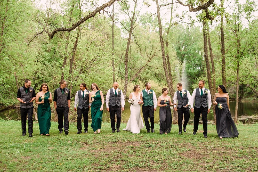 Wedding-Photography_backyard wedding-Mason City-Iowa_wedding party walking-iowa+wedding+photographer.jpeg