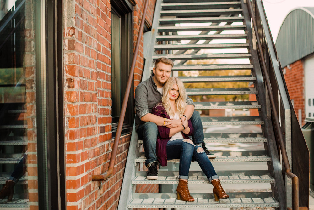 Engagement-Photography-The-Iowa-Tap-Room-Des-Moines-Iowa-sitting-on-staircase-looking-iowa+engagement+photographer.jpg
