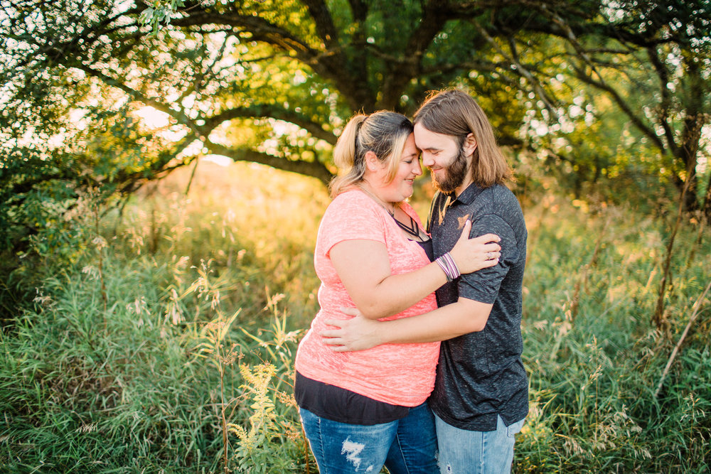 Engagement-Photography-Brushy-Creek-Recreation-Area-Lehigh-Iowa-intimate-moment-in-front-of-tree-iowa-engagement-photographer.jpg
