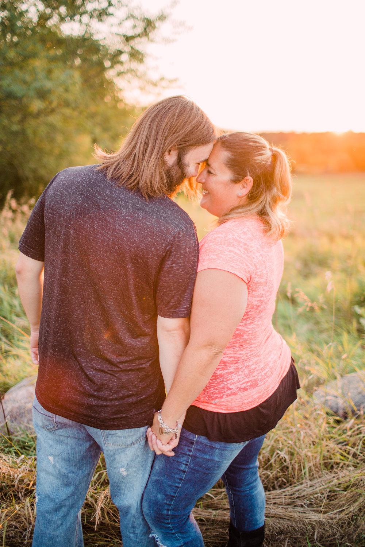 Engagement-Photography-Brushy-Creek-Recreation-Area-Lehigh-Iowa-standing-in-field-facing-each-other-iowa-engagement-photographer.jpg