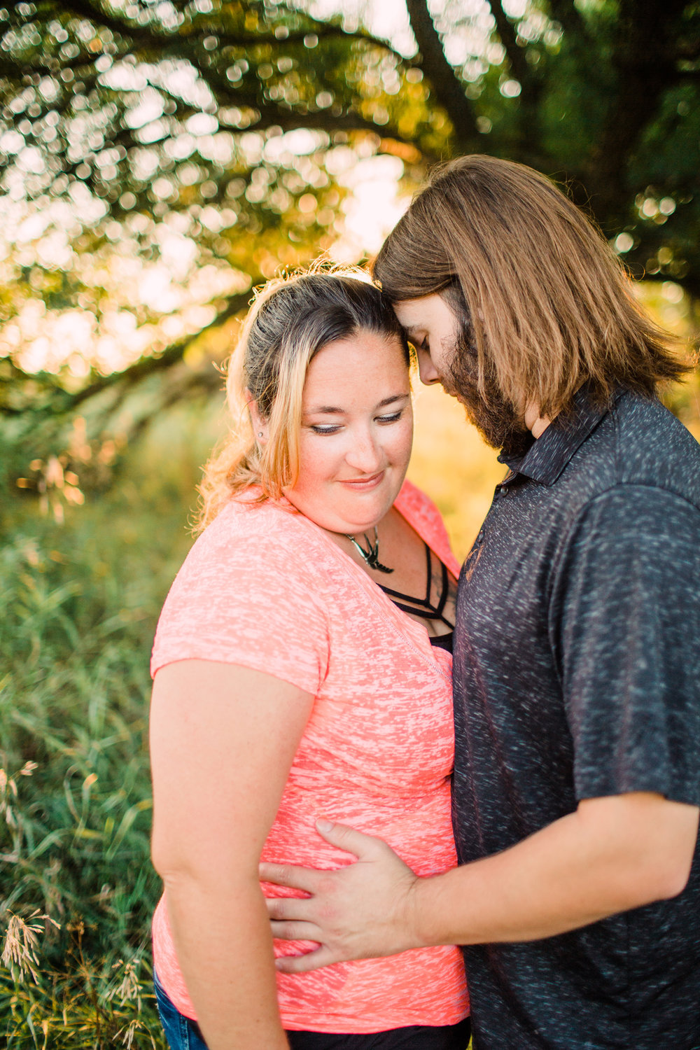 Engagement-Photography-Brushy-Creek-Recreation-Area-Lehigh-Iowa-embracing-with-girl-looking-down-iowa-engagement-photographer.jpg