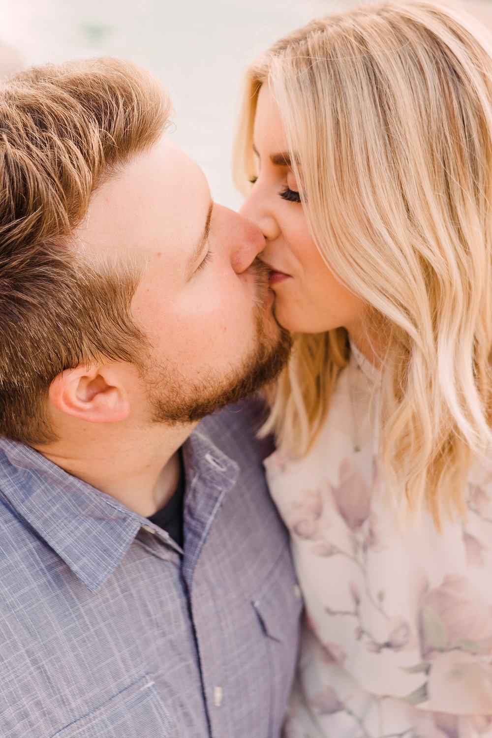 engagement photography-kissing in front of fountain-iowa state university-ames-iowa-iowa engagement photographer.jpg