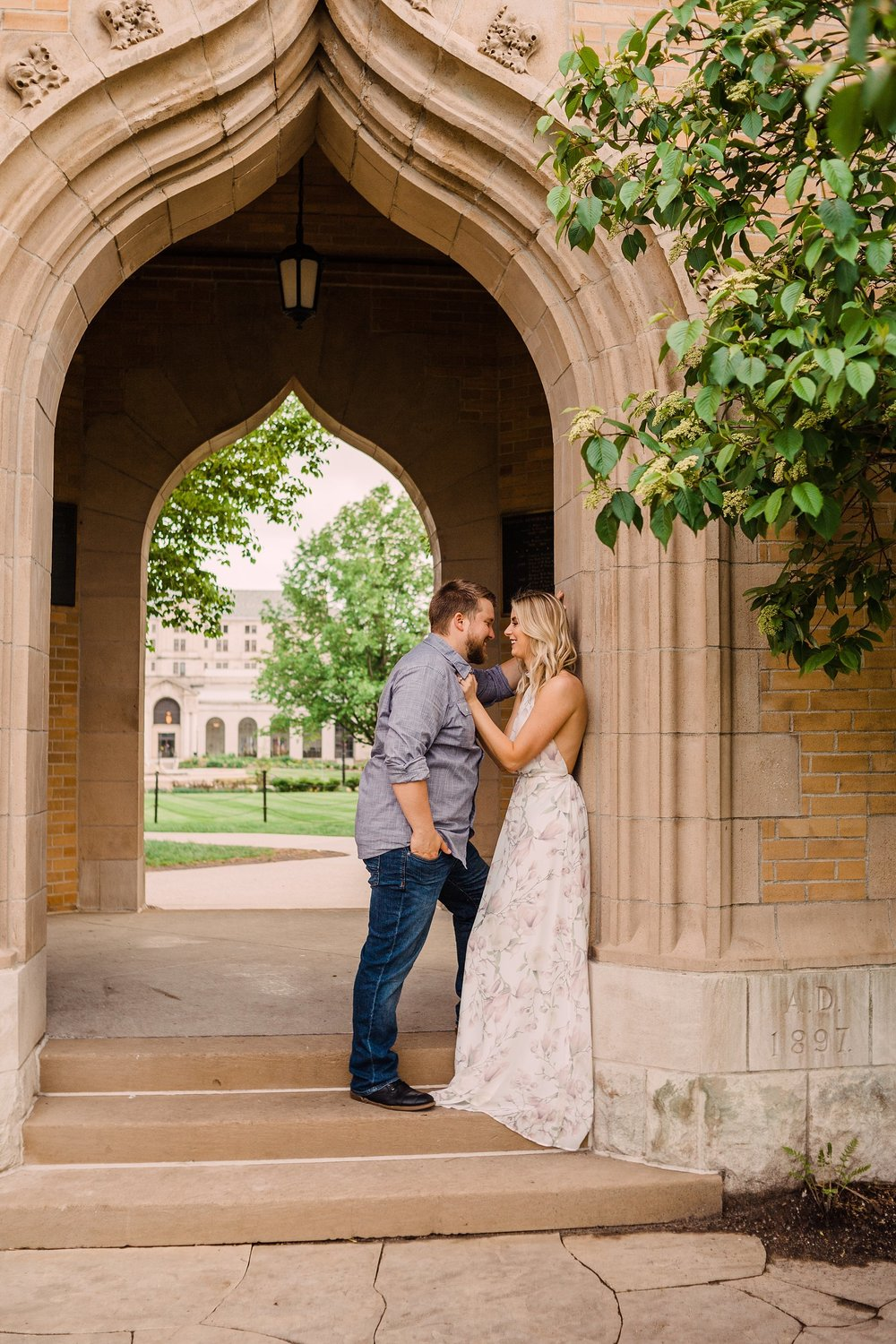 engagement photography-couple standing in campanile embracing-iowa state university-ames-iowa-iowa engagement photographer.jpg