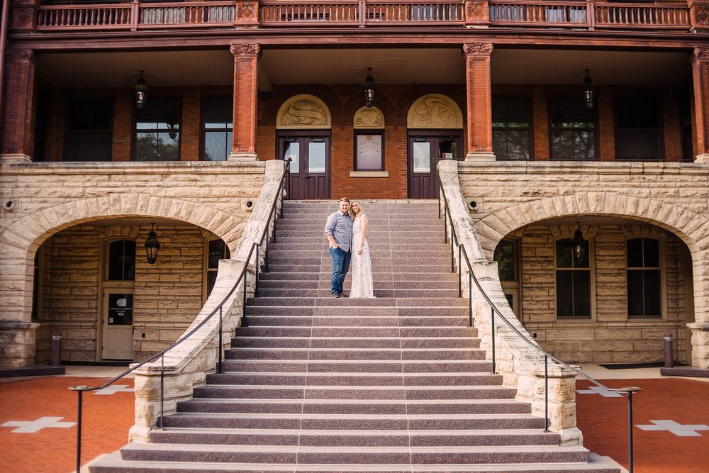 engagement photography-couple standing on steps of building-iowa state university-ames-iowa-iowa engagement photographer.jpg