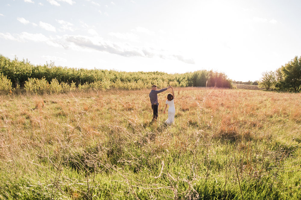 Engagement-Photography-Open-Field-along-Highway-Fort-Dodge-Iowa-dancing-in-field-at-sunset-iowa+engagement+photographer.jpg