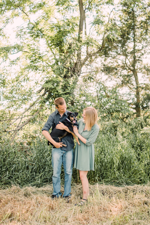 Engagement-Photography-Private-Farm-Mount-Auburn-Iowa-candid-with-dog-iowa-engagement-photographer.jpg