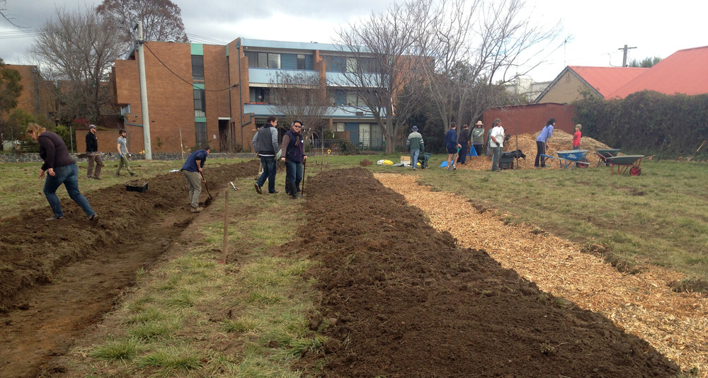 Mulching the swales at Lyneham Commons.