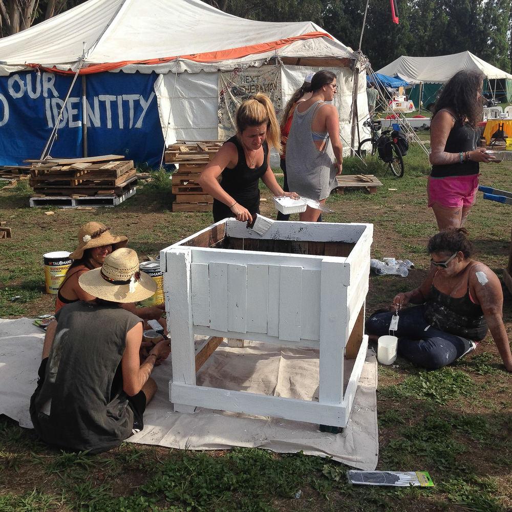 Volunteers building the community garden at the Aboriginal Tent Embassy.