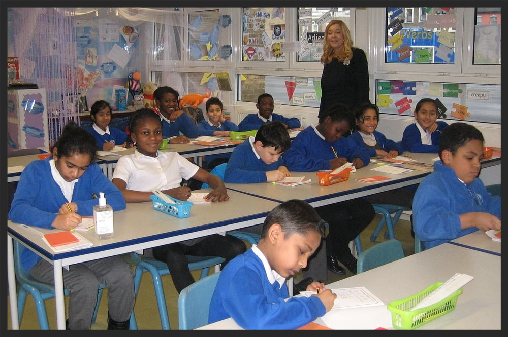 Ms Boreham, Assistant Headteacher and Class 11 teacher, with some of her students.