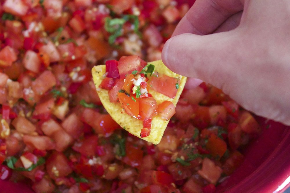 chip in salsa made represents hot sauce