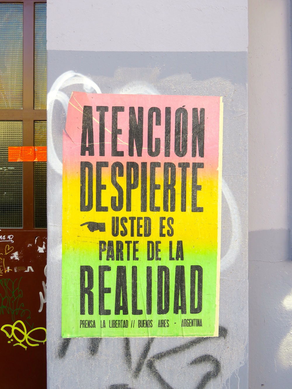"""""""You Are Part of Reality,"""" Prensa la Libertad, Argentina. The group also added interactive signs to the fence around the former Cuvrybrache squat, inviting passersby to add their own words."""