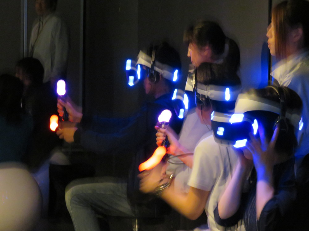 A glimpse of the future, with attendants: VR headsets and handsets in action