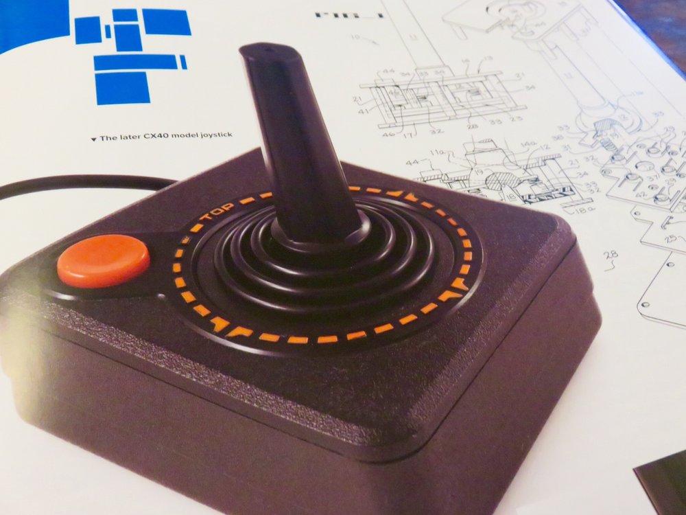 Original one-button Atari joystick with circuitry schematic.©The Art of Atari