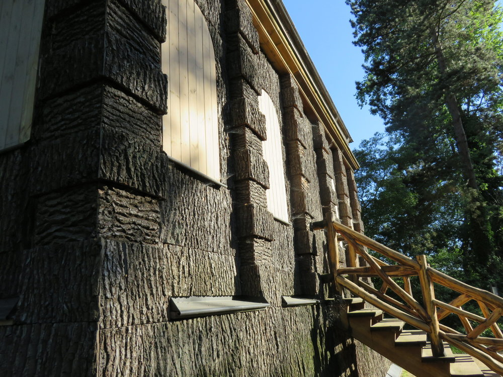 This large hunting blind at the island's southeastern shore features the curious juxtaposition of regal columns made from rustic treebark. The structure's lower floor has narrow slats that face the water, through which rifles could be fired.