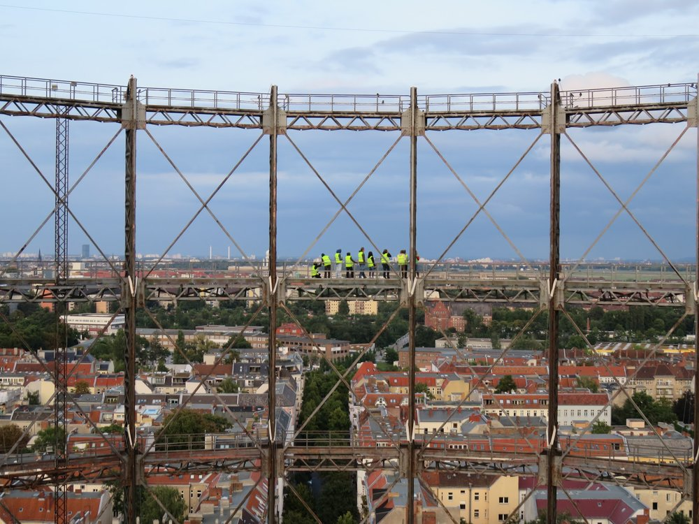 The view across the center of the structure, with a group of yellow-vested visitors for scale.