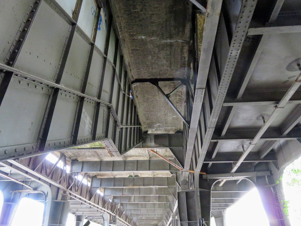 The riveted ironwork of the tracks and stairway under the platform of the former Bahnhof Wernerwerk.