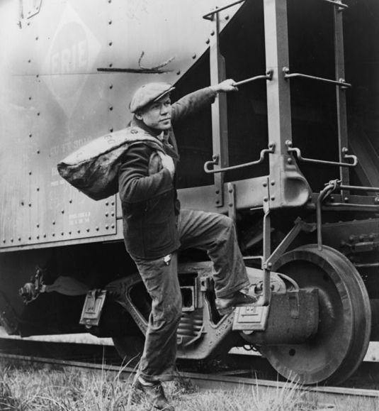 Lou Ambers climbs a train car,by Alan Fisher, New York World-Telegram and the Sun Newspaper Photograph Collection, Library of Congress - 1935 Source