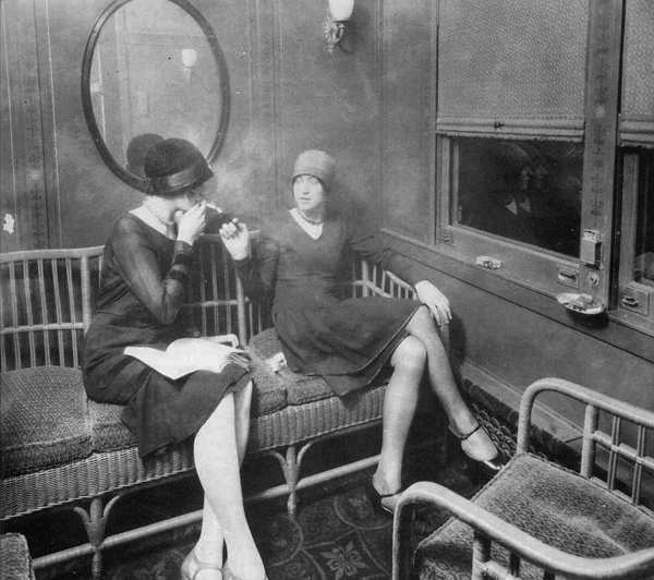 Flappers smoking in a car, Source