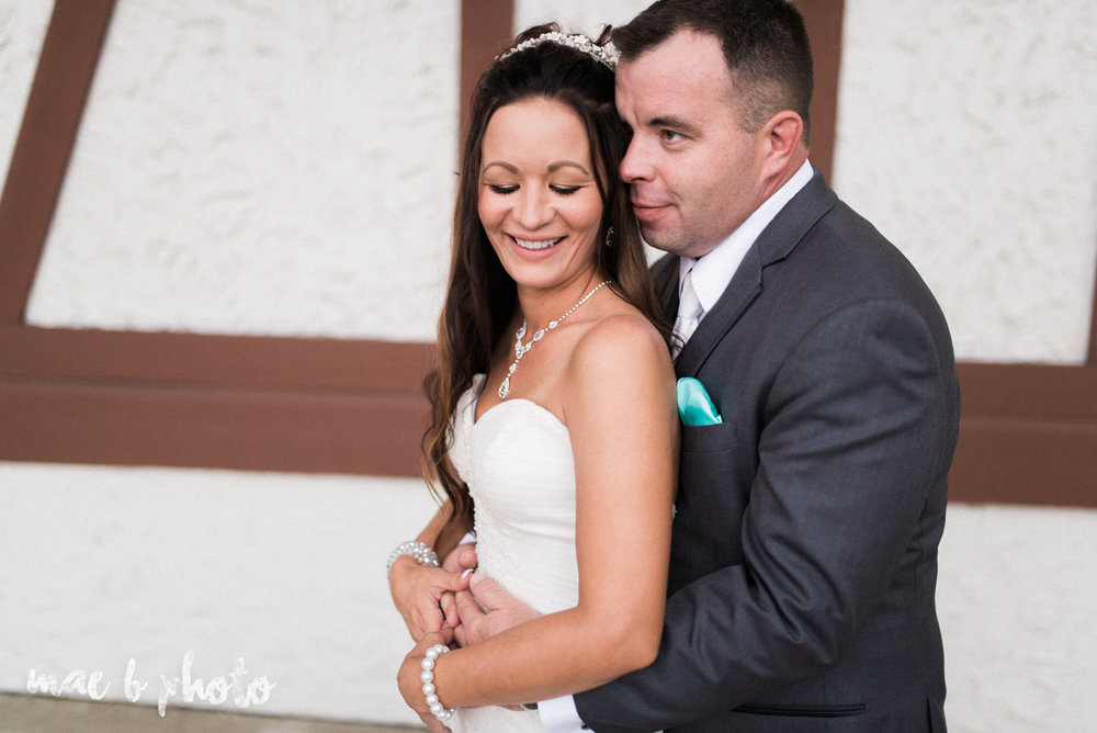 kristy and matt's summer wedding at the embassy in youngstown ohio photographed by youngstown wedding photographer mae b photo-17.jpg