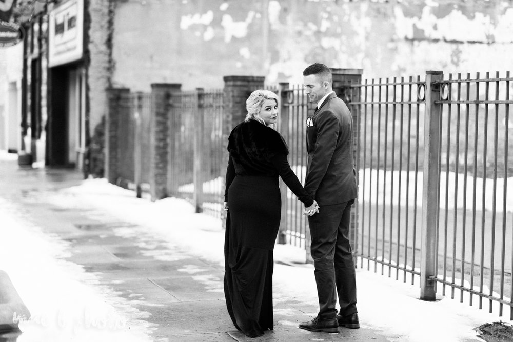 paige and cale's personalized winter glam engagement session at the butler institute of american art and downtown youngstown in youngstown ohio photographed by youngstown wedding photographer mae b photo-25.jpg