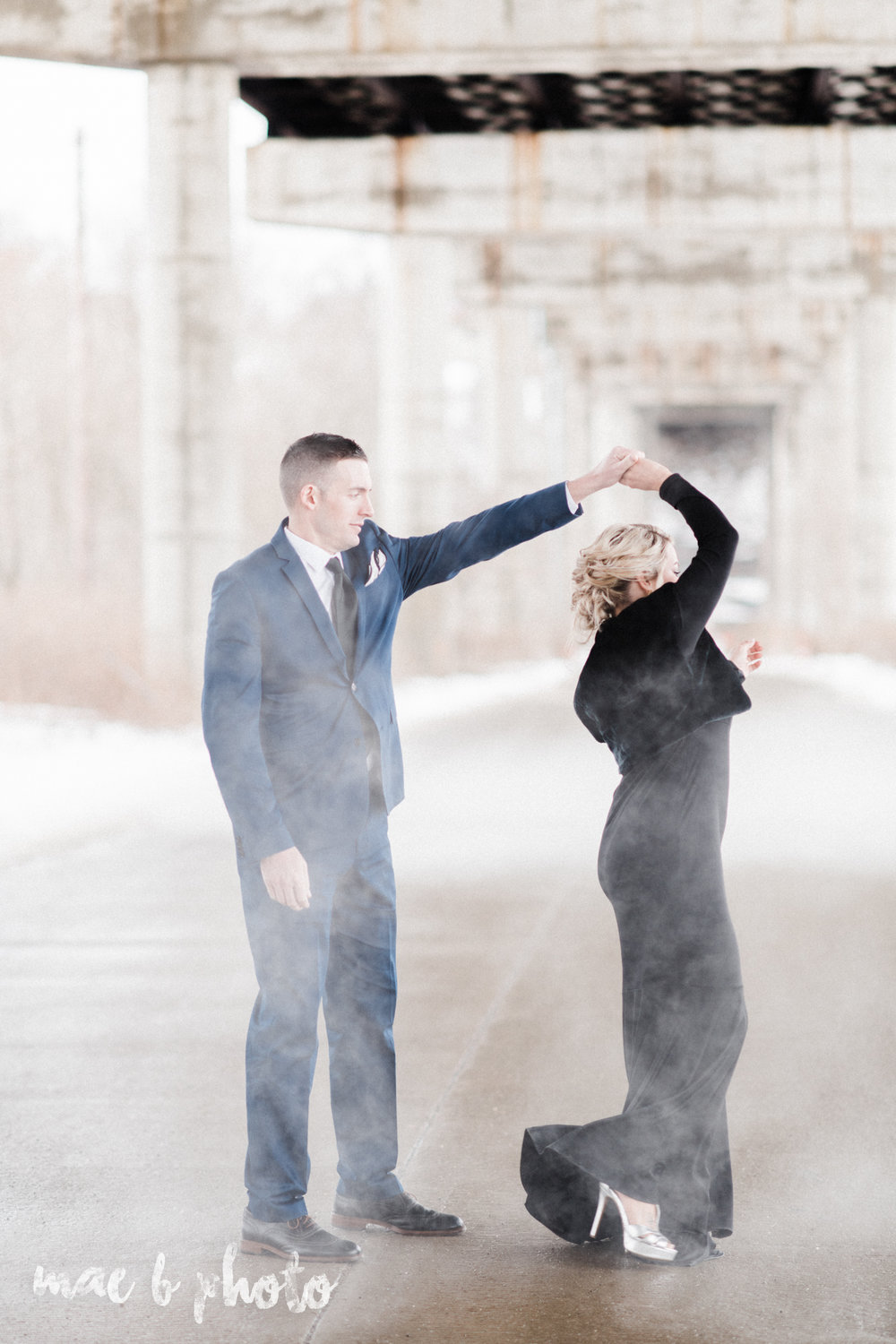 paige and cale's personalized winter glam engagement session at the butler institute of american art and downtown youngstown in youngstown ohio photographed by youngstown wedding photographer mae b photo-37.jpg
