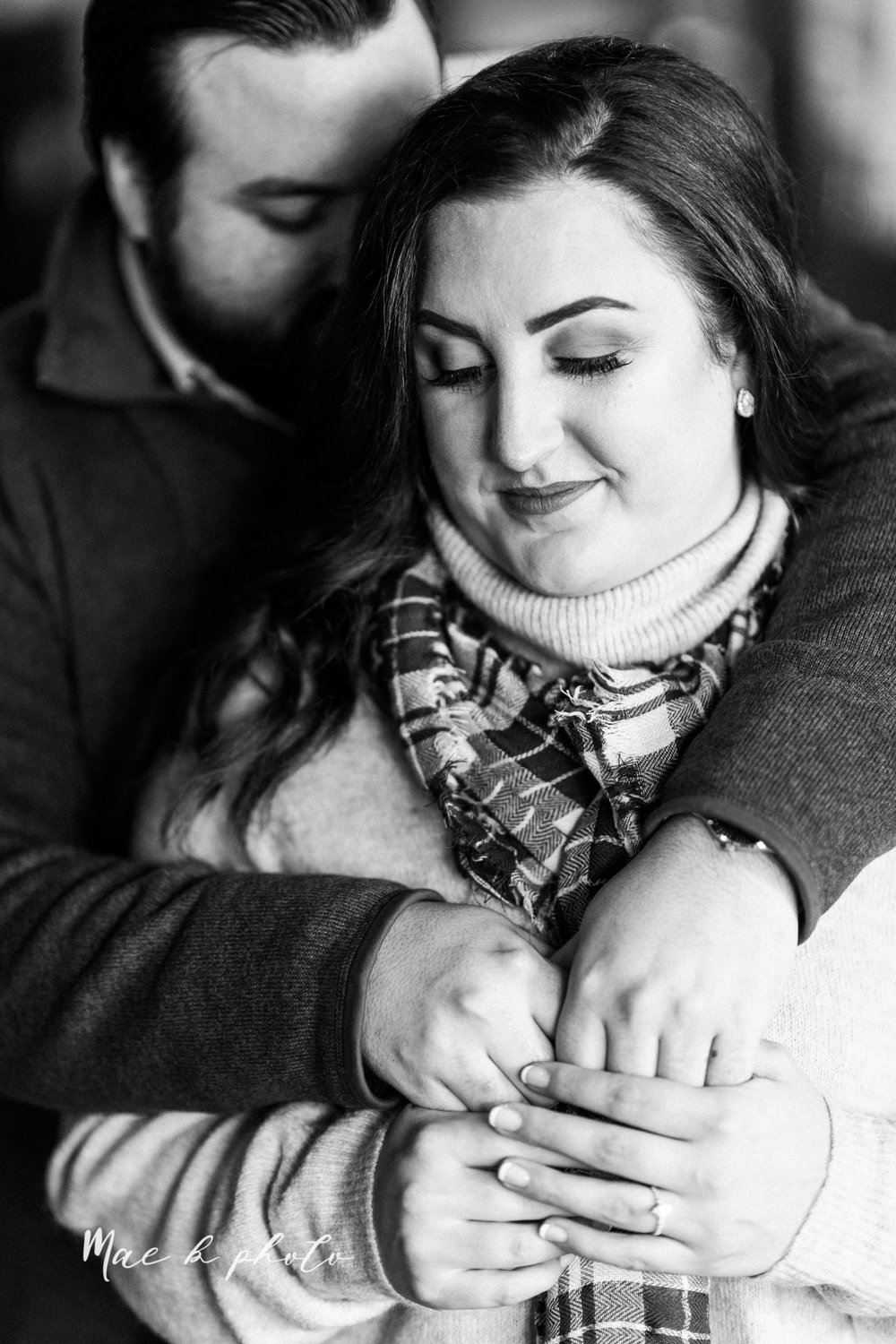 casey and matthew's personal winter cleveland engagement session at the clevelander and east fourth street and edgewater park in cleveland ohio photographed by youngstown wedding photographer mae b photo-15.jpg