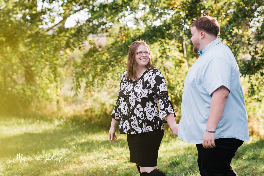 delorean and chase's backyard fall engagement session with youngstown state university shirts and a rescue dog from the mahoning county dog pound photographed by youngstown wedding photographer mae b photo-21.jpg