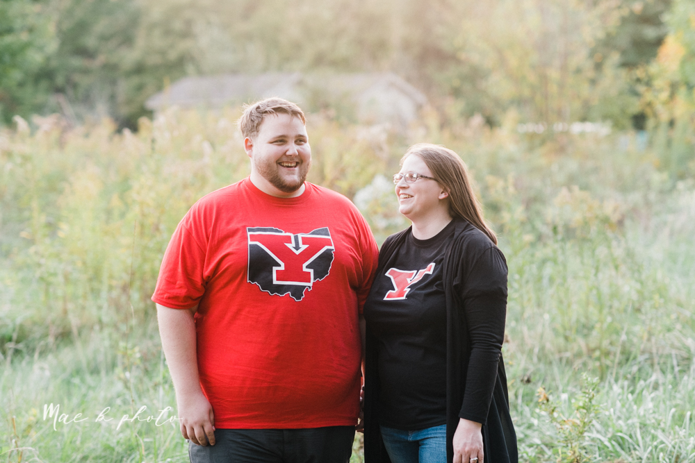 delorean and chase's backyard fall engagement session with youngstown state university shirts and a rescue dog from the mahoning county dog pound photographed by youngstown wedding photographer mae b photo-41.jpg