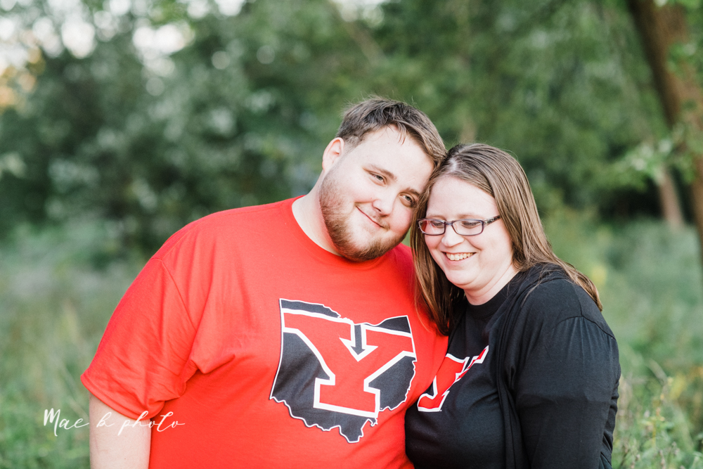 delorean and chase's backyard fall engagement session with youngstown state university shirts and a rescue dog from the mahoning county dog pound photographed by youngstown wedding photographer mae b photo-46.jpg