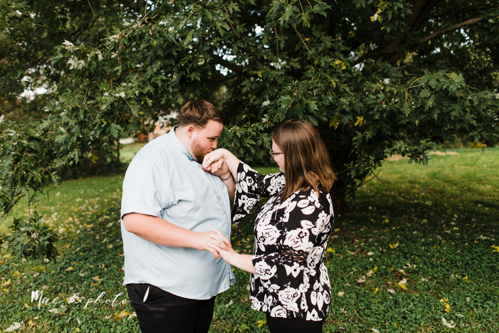 delorean and chase's backyard fall engagement session with youngstown state university shirts and a rescue dog from the mahoning county dog pound photographed by youngstown wedding photographer mae b photo-5.jpg