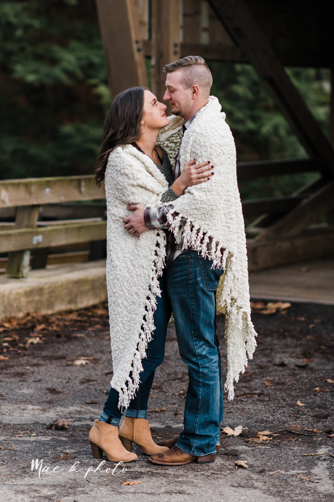 shelby and tyler's winter engagement session in northeast ohio at the cinderella bridge silver bridge and lanterman's mill in mill creek park in youngstown ohio photographed by youngstown wedding photographer mae b photo-43.jpg