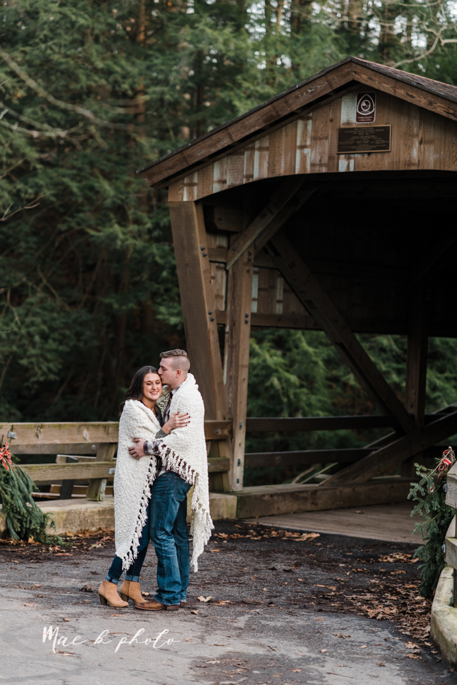 shelby and tyler's winter engagement session in northeast ohio at the cinderella bridge silver bridge and lanterman's mill in mill creek park in youngstown ohio photographed by youngstown wedding photographer mae b photo-42.jpg