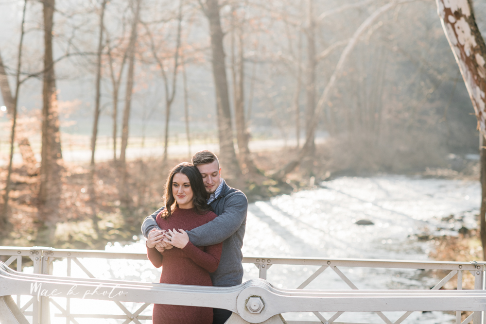 shelby and tyler's winter engagement session in northeast ohio at the cinderella bridge silver bridge and lanterman's mill in mill creek park in youngstown ohio photographed by youngstown wedding photographer mae b photo-4.jpg