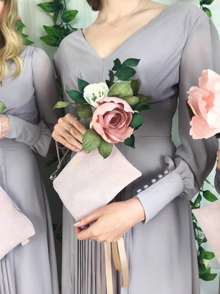 Our favourite option for wedding clutches are  Suede & Co  - they are so gorgeous and handmade, you can even have them monogrammed. If you like the matching paper flower posies you can find those  here.