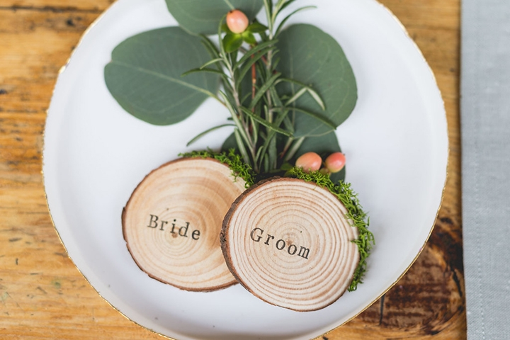 Wood slice and moss place cards , personalised with your guests names, available in the shop.