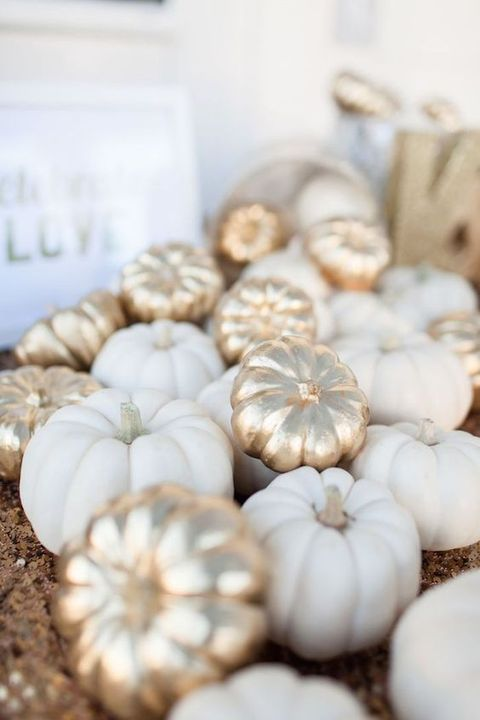 Painted pumpkins add a touch of sophistication to an Autumn trend.  Image via