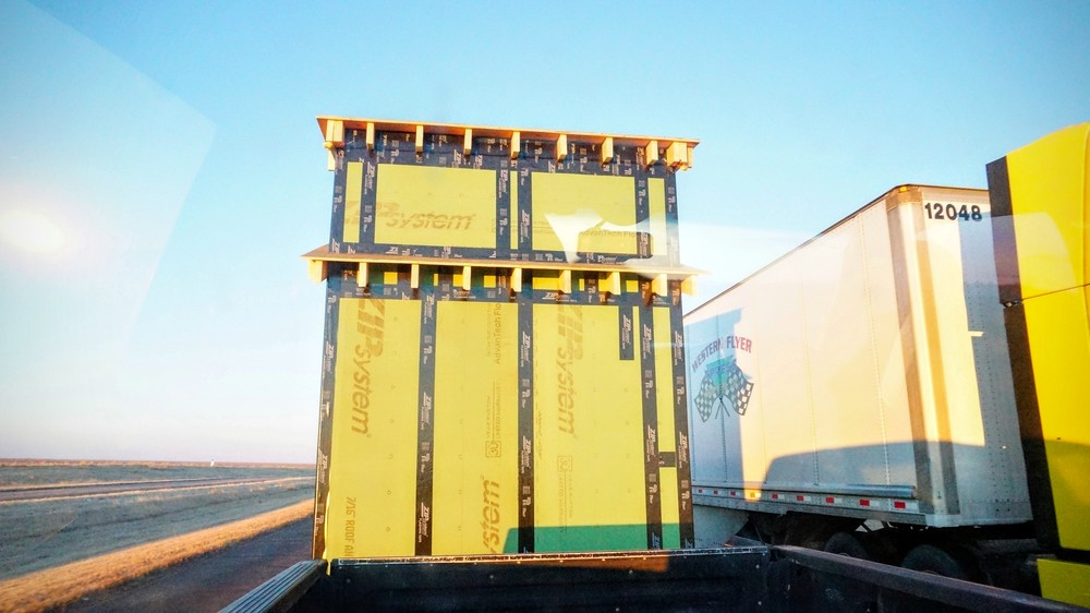 The tiny house stands as tall if not taller than an average semi trailer!