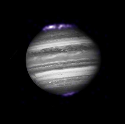The aurorae of Jupiter, as seen in visible light (black and white) and X-rays (purple). Jupiter's aurorae are hundreds of times more energetic than those on Earth. Image credit: X-ray: NASA/CXC/SwRI/R.Gladstone et al.; Optical: NASA/ESA/Hubble Heritage (AURA/STScI)
