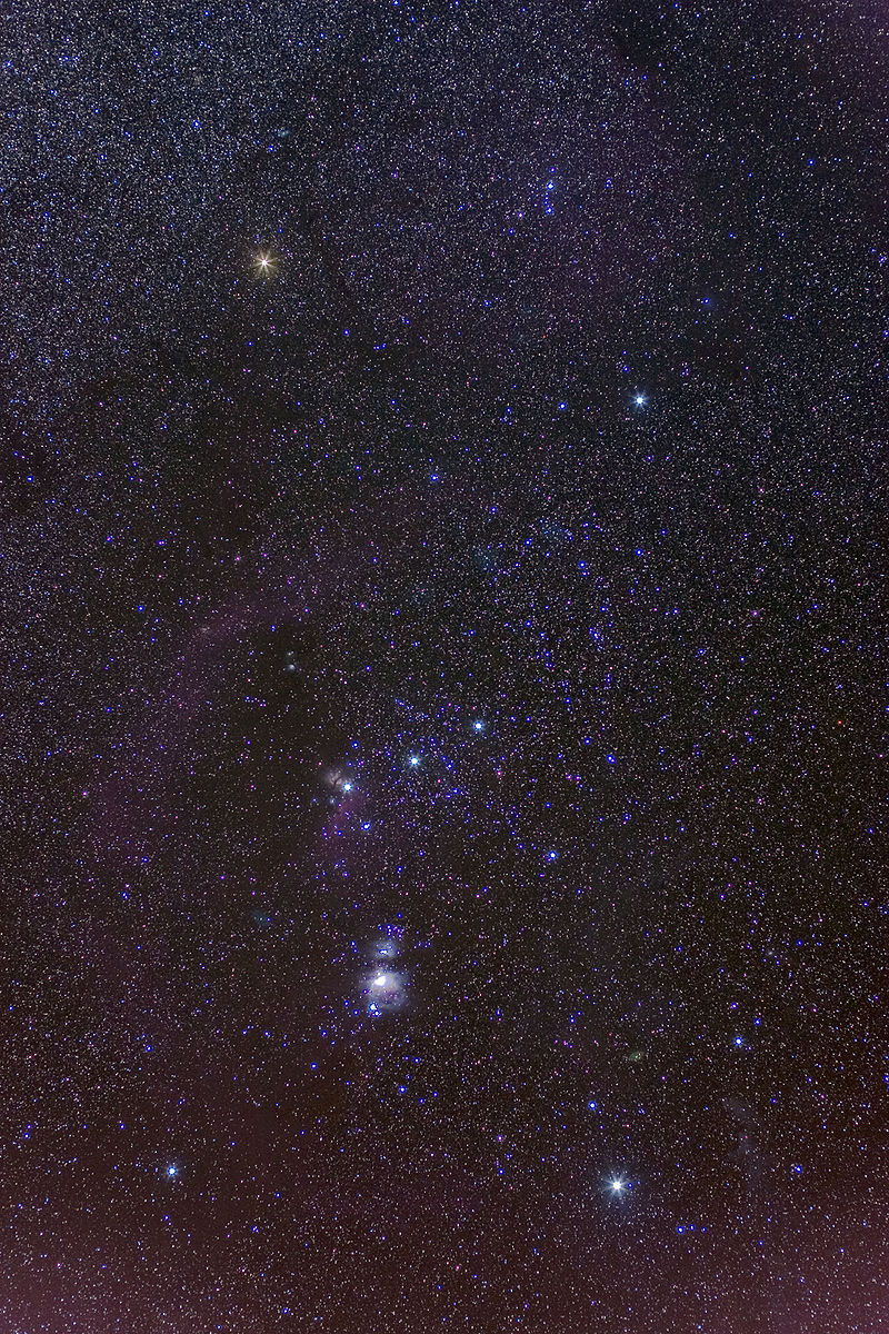 "[The Orion Nebula can be seen with the naked eye. It is the middle of three stars in the ""sword"" of Orion, located just below the belt. Image credit:  Mouser  - Own work]"