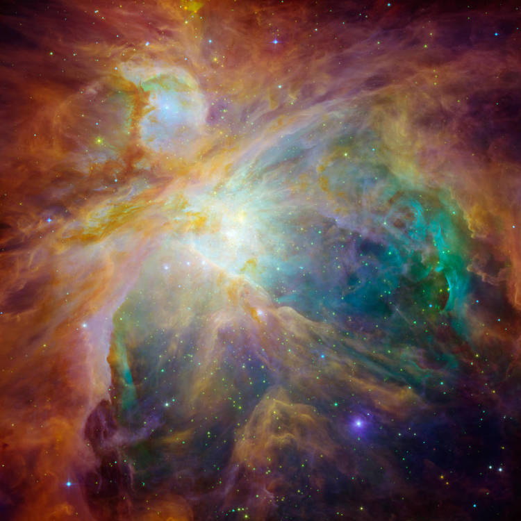 HOT, YOUNG STARS HEAT UP THEIR GASEOUS SURROUNDINGS IN THE ORION NEBULA. IMAGE CREDIT: NASA