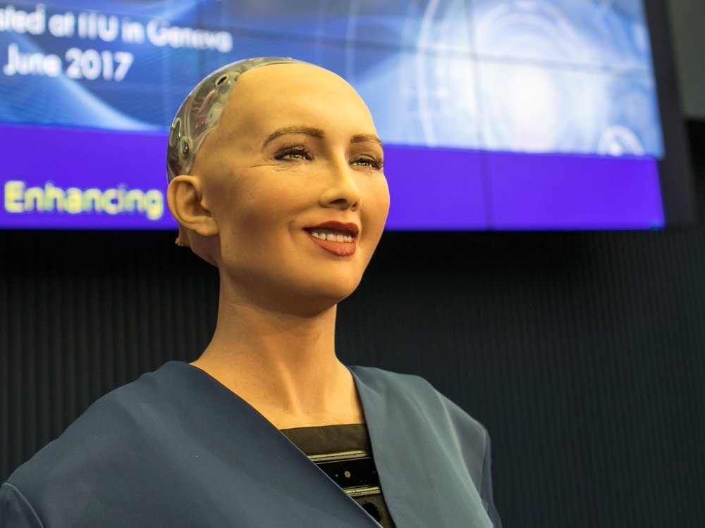 Figure 1: Sophia the robot speaking at the AI for GOOD Global Summit 2017 in Switzerland. Licensed under CC BY 2.0.