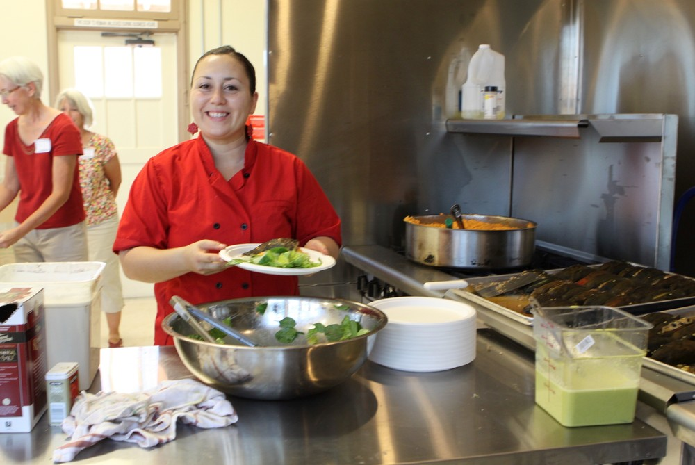 Local chef Christina Vega-Zubiate catering a meal