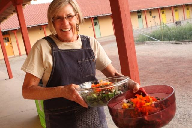 Serving salads made from produce grown on-site in the Many Hands Urban Farm
