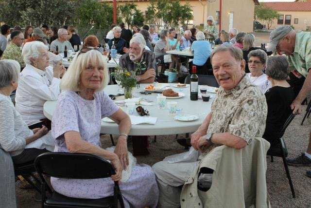 Guests enjoying a farm-to-table meal in the courtyard at an event hosted by the Ajo Center for Sustainable Agriculture